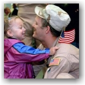 Child hugging American Veteran