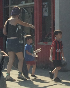 Mom and kids cleanup sidewalk